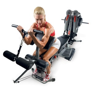 a woman does bicep curls using the bowflex revolution