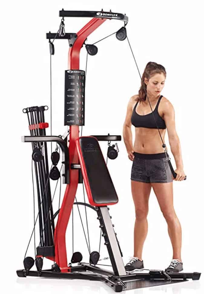 a woman doing a pulley exercise on the pr3000