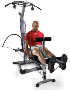 a man does leg curls on his new home gym