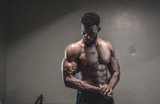 a bodybuilder flexes his biceps