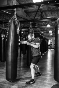 a man boxes in the gym