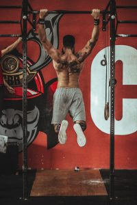 a guy does pull ups