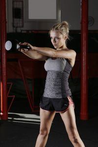a woman does kettlebell workout