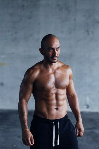 a man shows off his ripped body after taking testosterone boosters