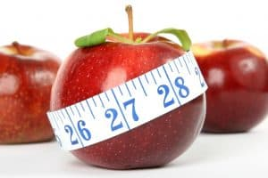 an apple with a tape measure around it