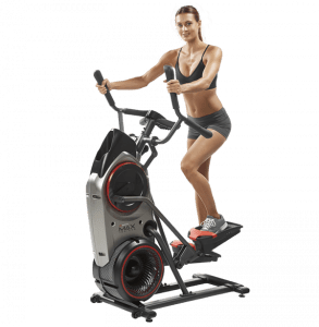 a woman rides the m5 max trainer