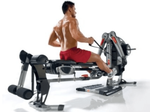 a guy uses the bowflex revolution as a rowing machine