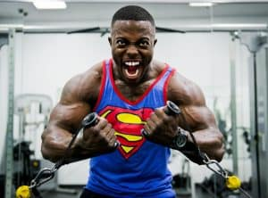 a guy with huge muscles lifts weights after taking a free testosterone booster