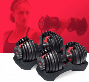 a pair of selecttech 552s with a fitness model lifting weights in the background