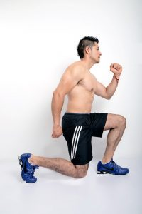 a guy does lunges as part of the leg burner workout