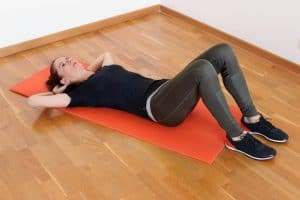 a woman gets ready to do a partial crunch