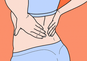 a woman holds her back in pain