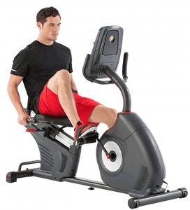 a man rides a recumbebent bike