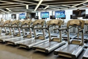 a row of treadmills in the gym