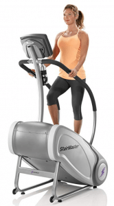a woman rides the stairmaster sm3 stepmill