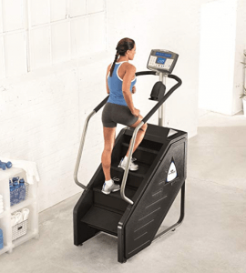 a woman uses a stairmaster in her home gym