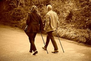 an older couple walking on a path
