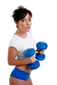 a woman with dumbbells gets ready to do flys