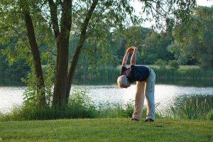 an older man does yoga