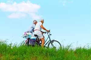 an older couple goes for a bike ride