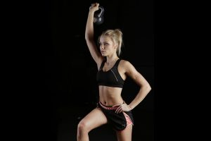 A woman does a isokinetic kettlebell workout