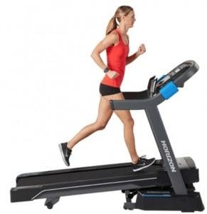 A woman runs on the Horizon 7.0 AT treadmill