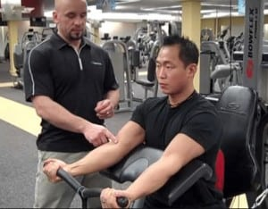 A guy does Preacher Curls on the 2 SE