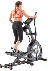 a woman uses the schwinn 470 elliptical