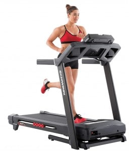 A woman runs on the schwinn 830 treadmill