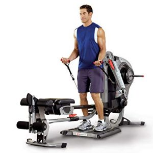 a guy does bicep curls on the bowflex revolution