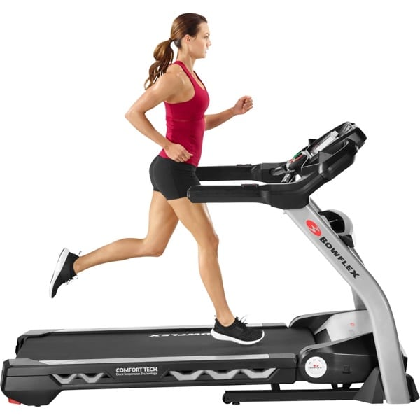 a woman runs on the bowflex treadmill