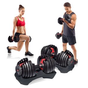 two people use the bowflex selecttech dumbbells