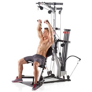 a guy uses the home gym for an intense workout