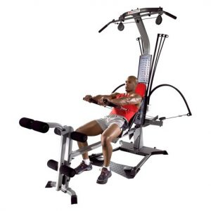 a guy does pec dec flys on the bowflex