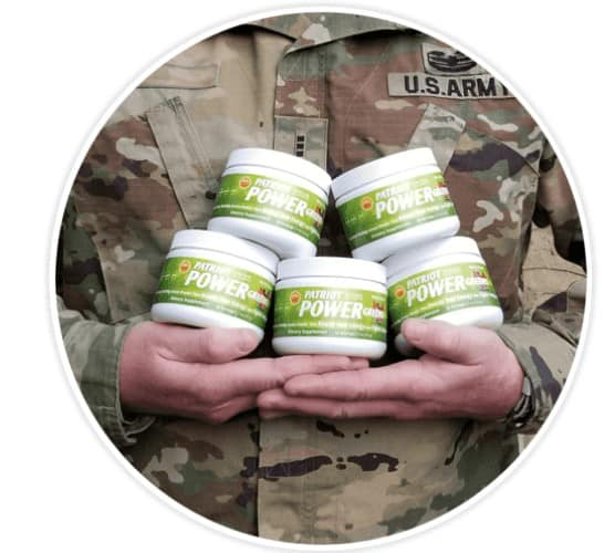 a soldier holds 5 jars of the green super powder