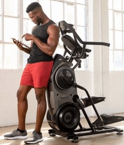 a guy next to his max trainer trying to pick the best weight loss workout