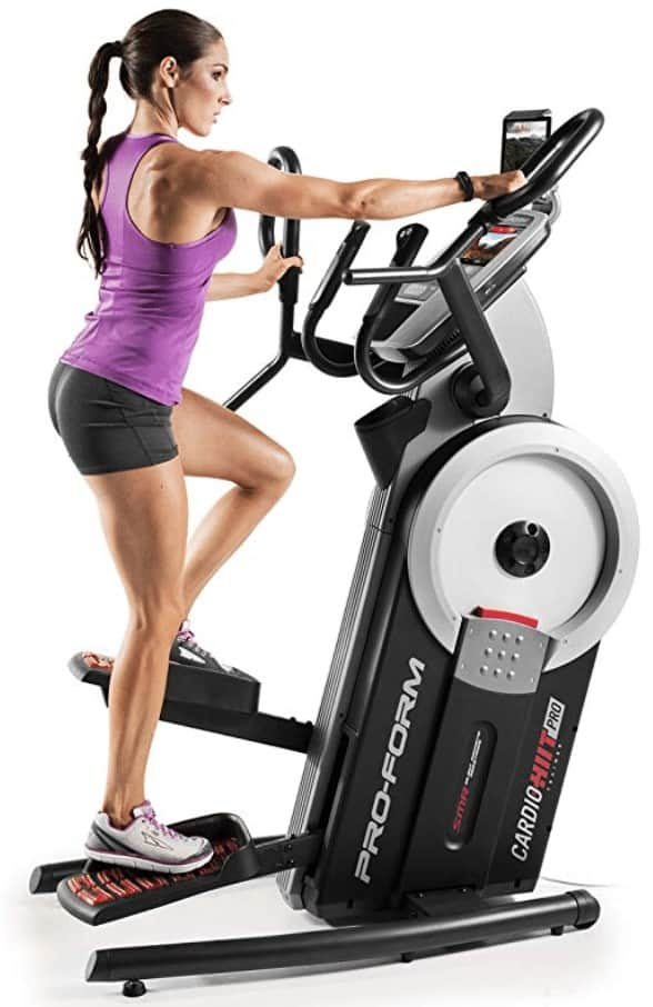 a side shot of a woman using the proform hiit cardio trainer pro