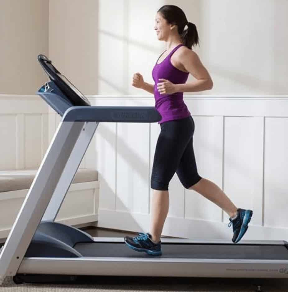 a woman running on her new treadmill