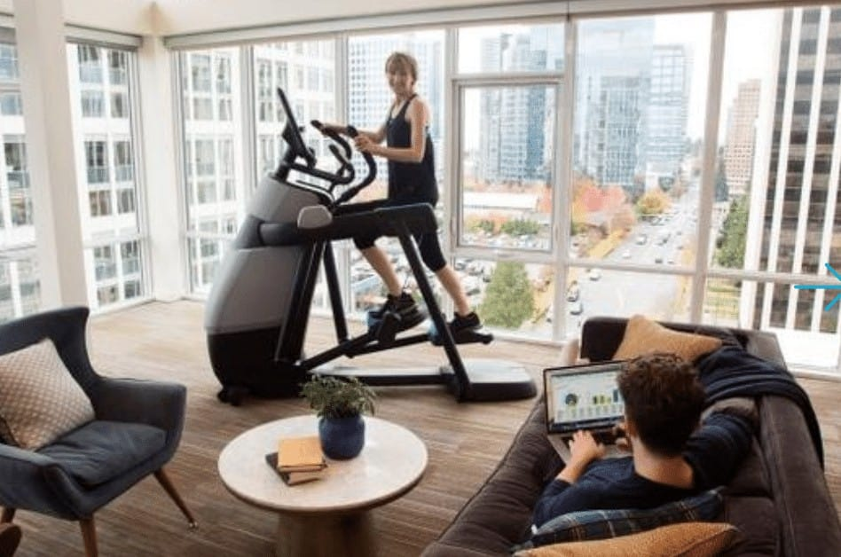 a woman does an amt workout at home