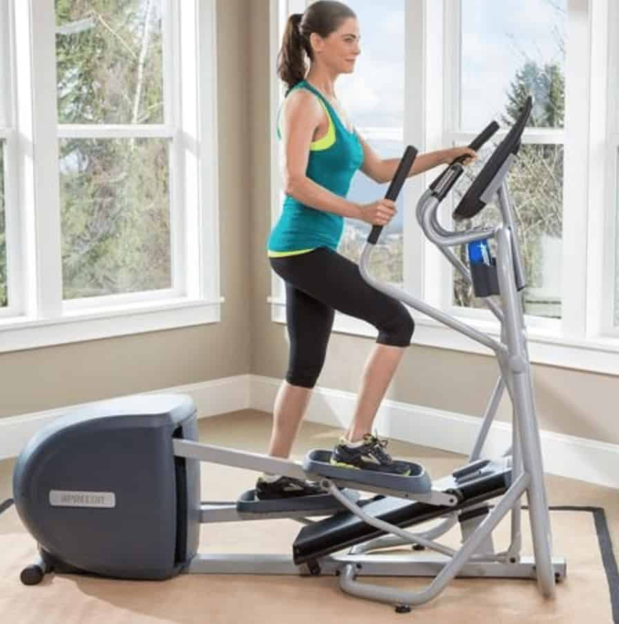 a woman rides the efx 200 elliptical
