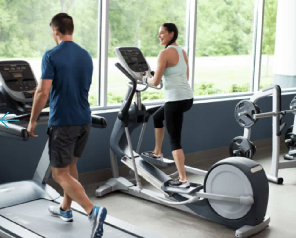 a woman uses an EFX700 elliptical at the gym