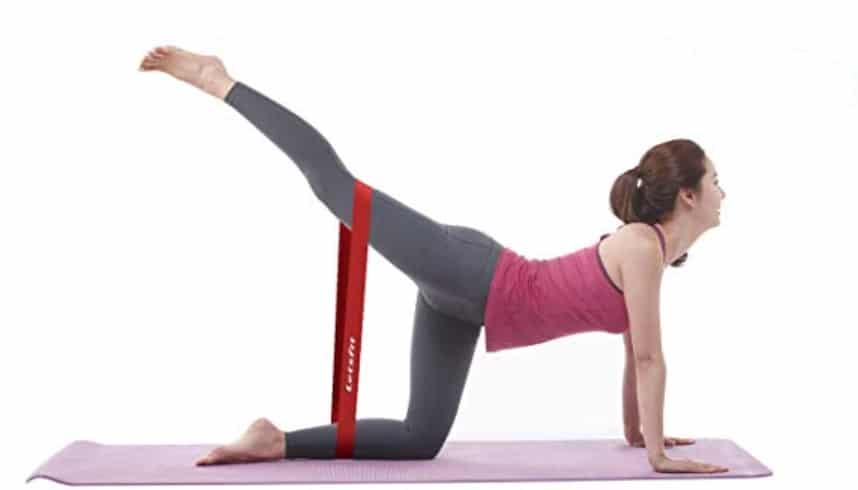 a woman does a resistance band leg workout