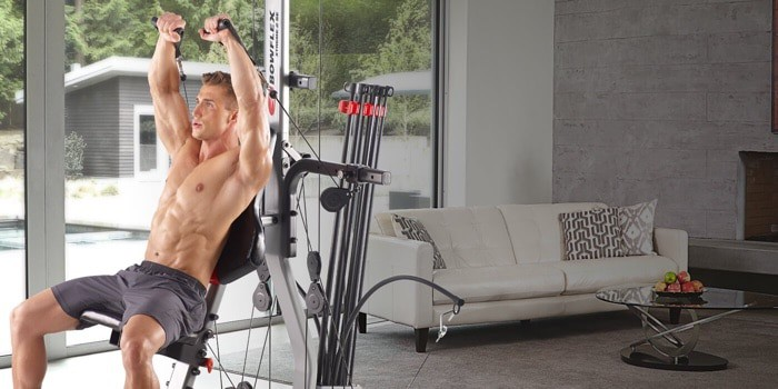 a guy using his Bowflex home gym