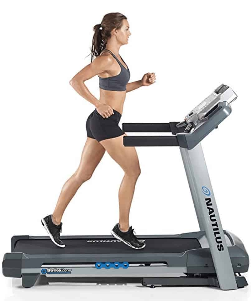 a woman jogging on the T614 treadmill